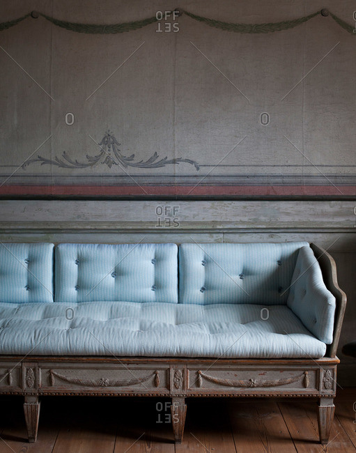 An antique sofa in a room