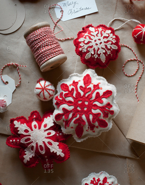 Stuffed snowflake ornaments and thread