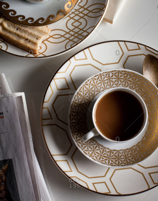 Cups of coffee on patterned saucers