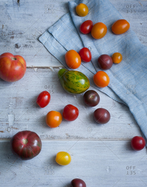 Various tomatoes on a wood background