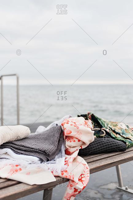 Clothes on bench near sea