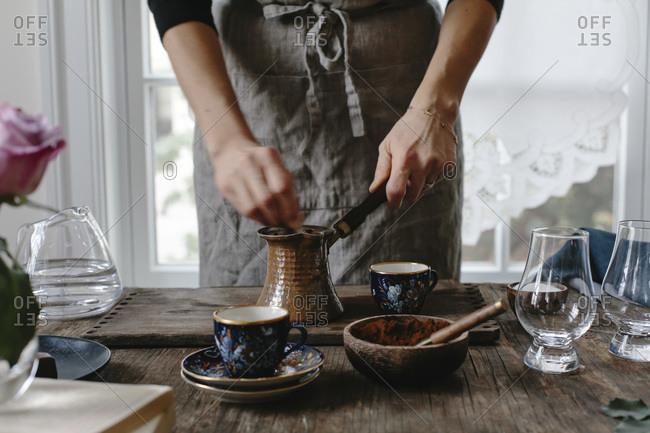 A woman preparing Turkish coffee