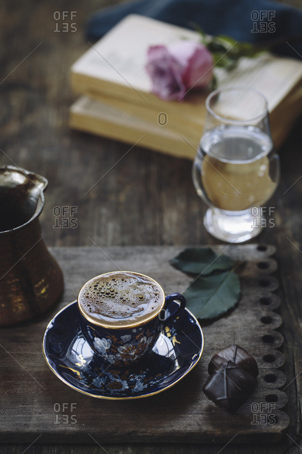 A cup of Turkish coffee on an ornate wood tray