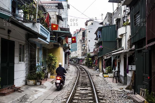 Hanoi, Vietnam - January 7, 2016: Train tracks between crowded houses in Hanoi, Vietnam