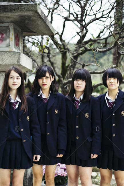 Kyushu, Japan - November 16, 2015: Schoolgirls at Dazaifu Shrine in Kyushu, Japan