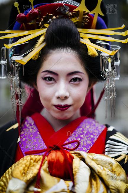 Fukuoka, Japan - November 16, 2015: Young Japanese woman dressed in traditional geisha robes in Fukuoka, Japan