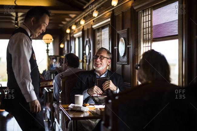 Japan - November 21, 2015: Diners having lunch on board the Seven Stars Kyushu luxury train in Japan