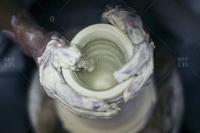 Hands of a person working in small porcelain and ceramics workshop in Kyushu, Japan