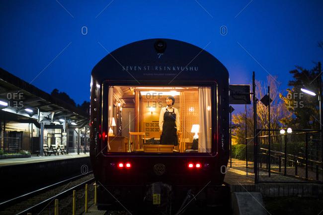 Japan - November 22, 2015: Seven Stars Kyushu luxury train at dawn near Mount Aso in Japan