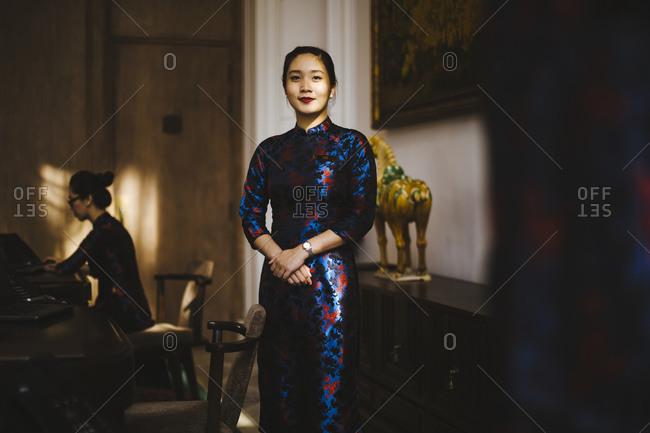 Ho Chi Minh City, Saigon, Vietnam - December 12, 2015: Receptionist at a luxury hotel in Ho Chi Minh City, Vietnam