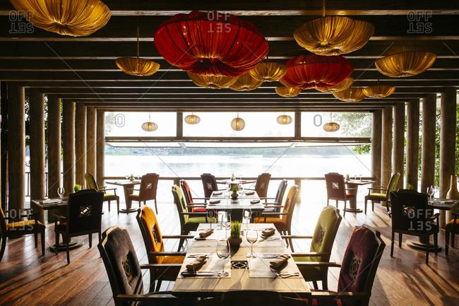 Saigon, Vietnam - December 17, 2015: Open air dining room at a riverside restaurant at An Lam Resort in Saigon, Vietnam