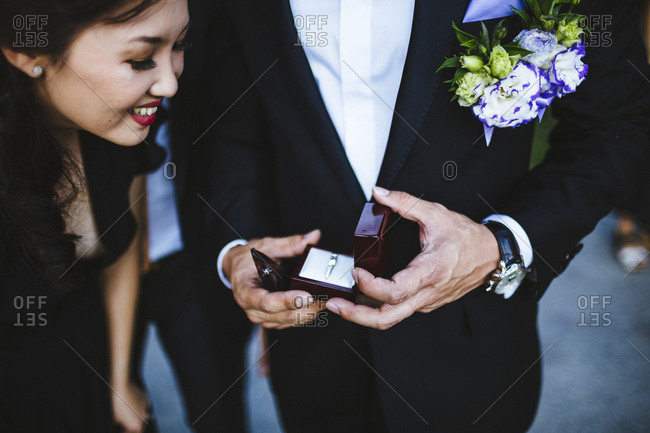 Bangkok, Thailand - April 11, 2014: Best man showing off the ring before a wedding ceremony