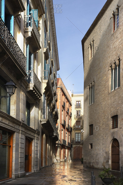 Narrow street flanked by old buildings