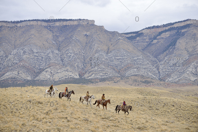 Cowboys and Cowgirls riding horse in wilderness, Rocky Mountain, Wyoming, USA