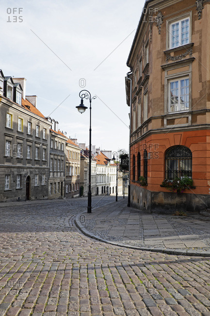Old buildings and lamp post on cobblestone street corner, Old Town, Warsaw, Poland
