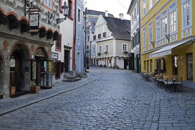 Cesky Krumlov, Czech Replublic - September 21, 2015: Cobblestone city street and historical buildings