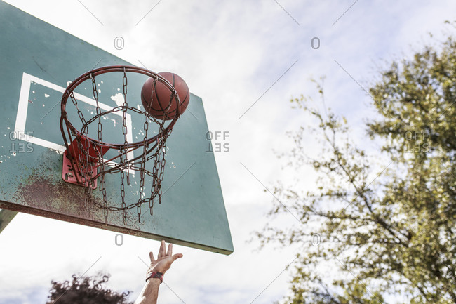 Hand making shot with basketball