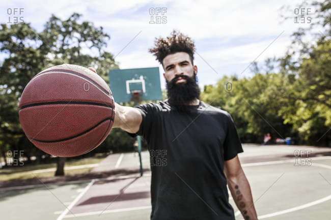 Man holding basketball in hand
