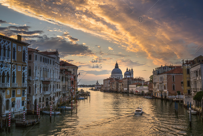Residential buildings on a Venetian canal at sunrise
