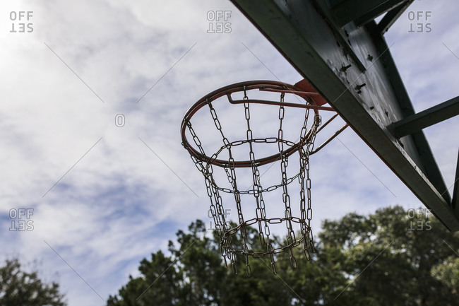 A basketball hoop with metal net