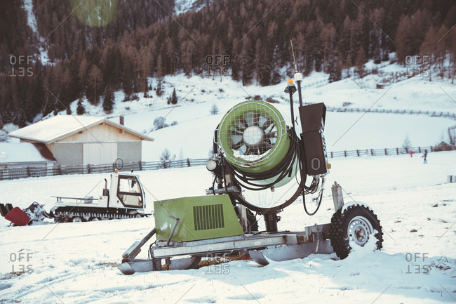 Snow cannon in winter landscape