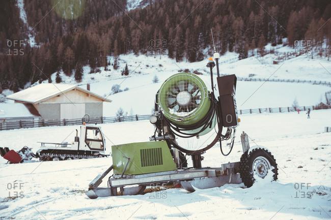 Snow cannon in winter landscape