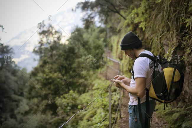 Man on hiking trip along the Levadas