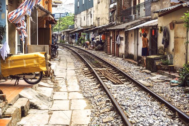 HANOI, VIETNAM - January 11, 2014: Train tracks through neighborhood, Vietnam