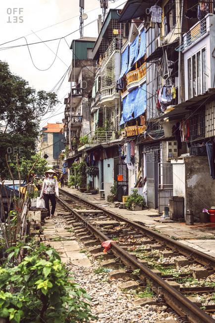 HANOI, VIETNAM - January 11, 2014: Train tracks past neighborhood, Vietnam