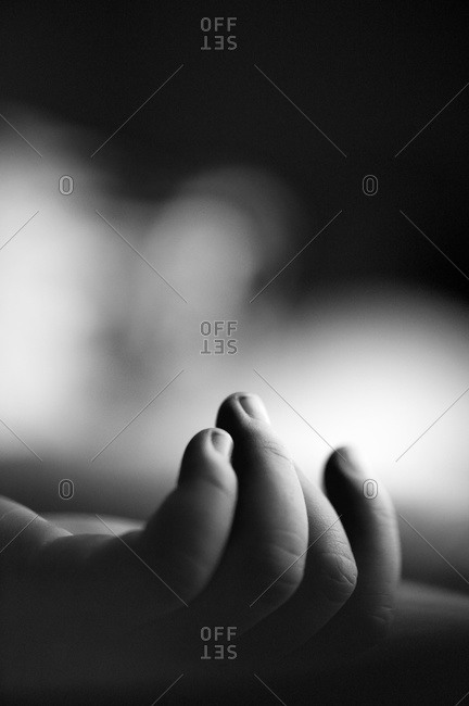 Close-up of a child's hand with fingers slightly curled upward