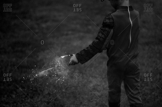 Boy holding sparklers