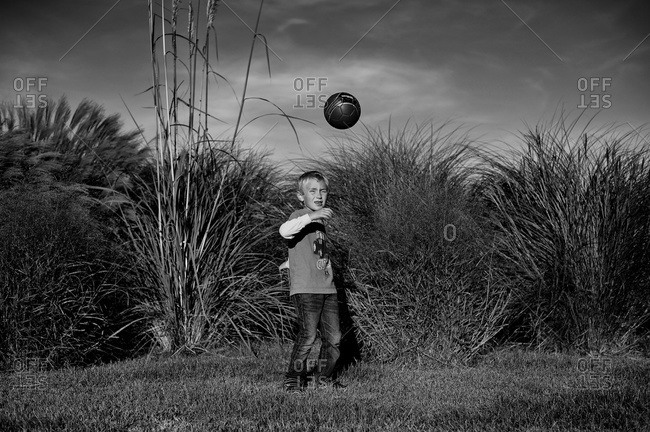 Boy playing with a ball outside