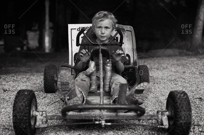 Boy sitting in a go kart