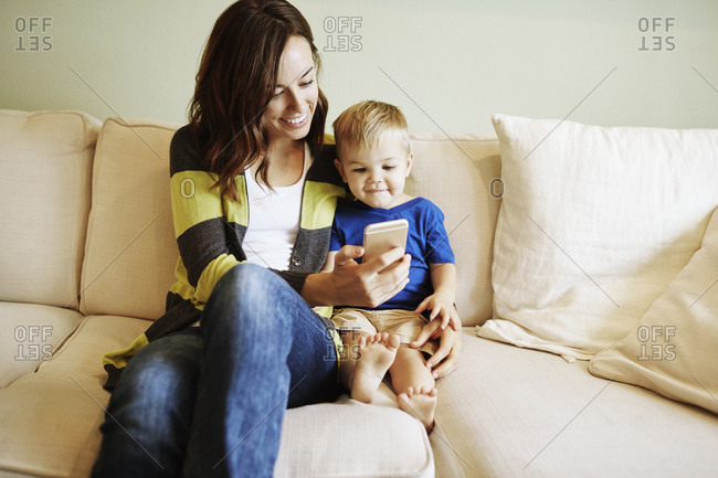 Woman and little boy looking at a cell phone
