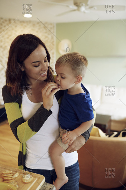 Woman and little boy having a snack