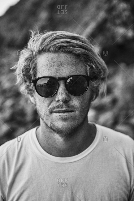 Portrait of a freckled young man in sunglasses