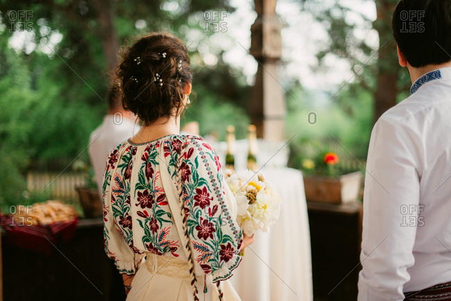 Back view of Romanian bride in traditional embroidered blouse