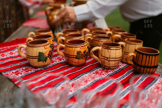 Close-up of traditional pottery mugs at a Romanian celebration