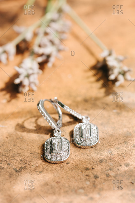 Two earrings on the ground