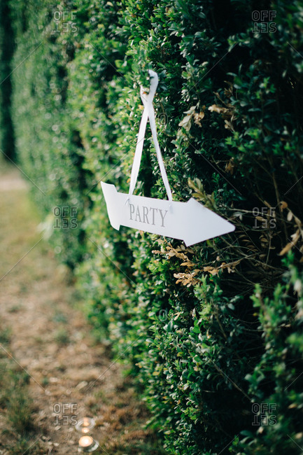 Sign pointing way to wedding party