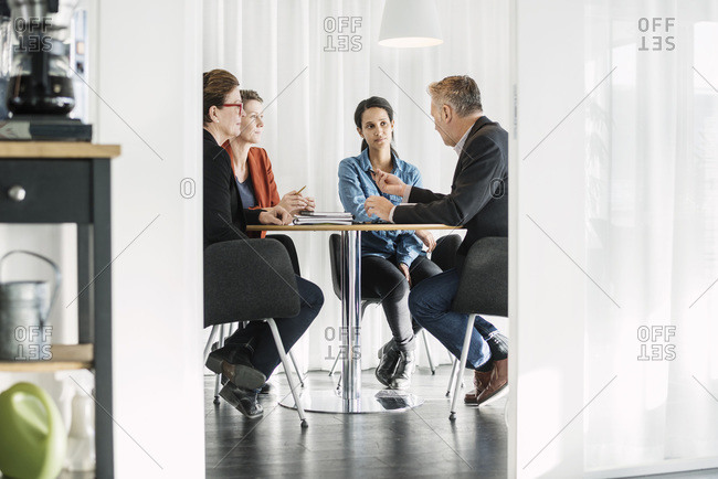 Businessman explaining business strategy to colleagues in meeting