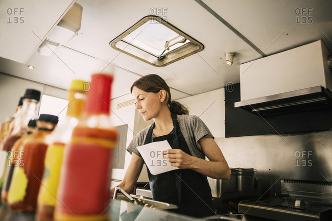 Female chef working in food truck
