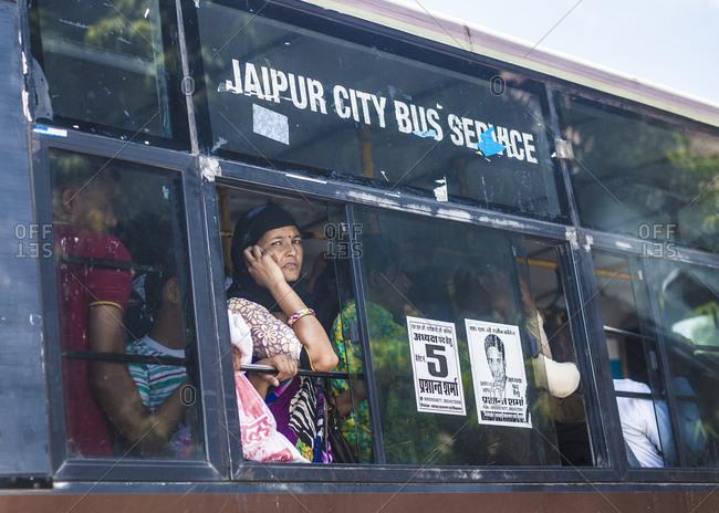 Jaipur, India - September 11, 2015: People using public transportation in Jaipur, India