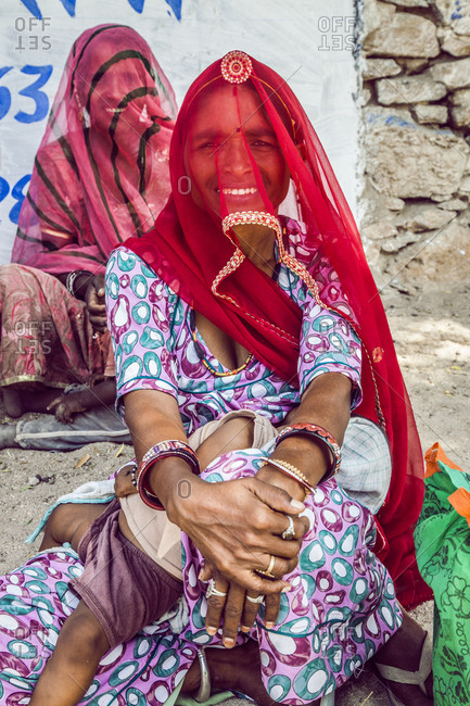 Rajasthan, India - September 12, 2015: Two Indian women sitting by the roadside in Rajasthan, India