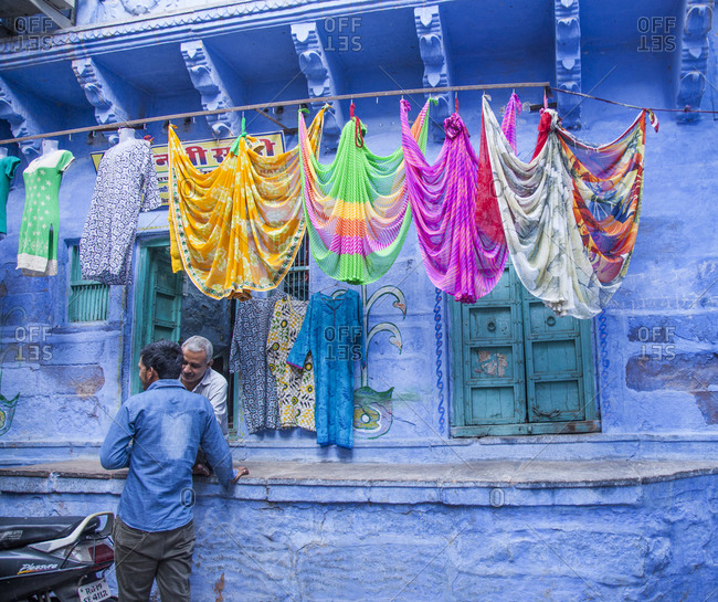 Rajasthan, India - September 12, 2015: Two Indian men standing outside a colorful building in Jodhpur, India
