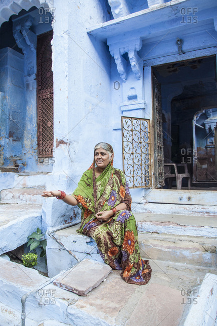 Rajasthan, India - September 12, 2015: Woman sitting on the steps of a residence in the city of Jodhpur, India