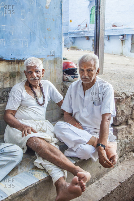 Rajasthan, India - September 12, 2015: Two men dressed in white sitting together in the city of Jodhpur, India