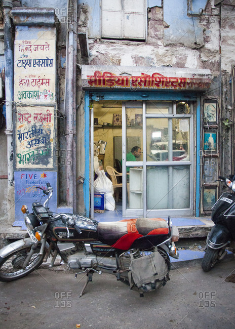 Rajasthan, India - September 12, 2015: Man working inside a small streetside office in the city of Jodhpur, India