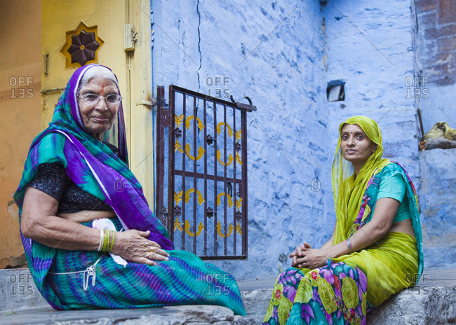 Rajasthan, India - September 12, 2015: Two women sitting outside a residence in the city of Jodhpur, India