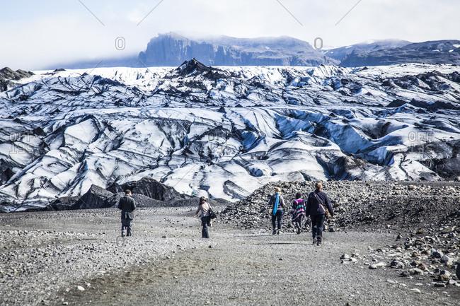People visiting glacier in Reykjavik, Iceland